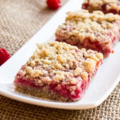These dessert squares with raspberries and oat crumble are sweet, tangy and totally delicious. Raspberries, oats, brown sugar, butter, flour and more