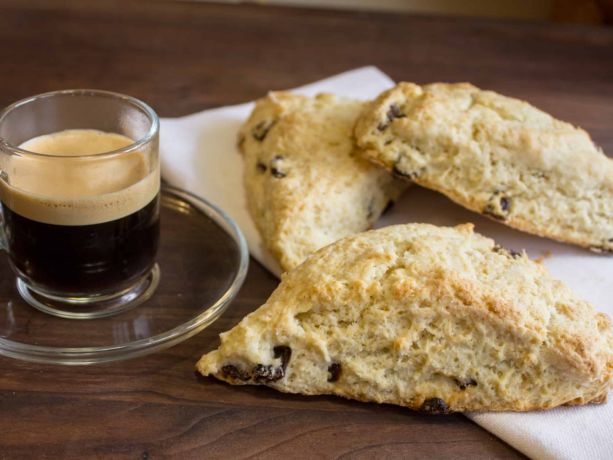 These raisin scones are buttery and flaky baked biscuits. Super easy to make and bake. The raisins can be substituted with dried cranberries or some fresh blueberries, strawberries etc.