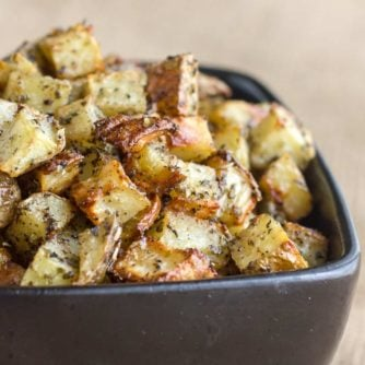 A bowl of oven roasted hash brown potatoes.
