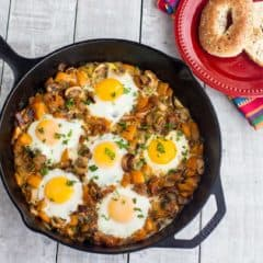 An overhead image of baked eggs in a cast iron skillet.