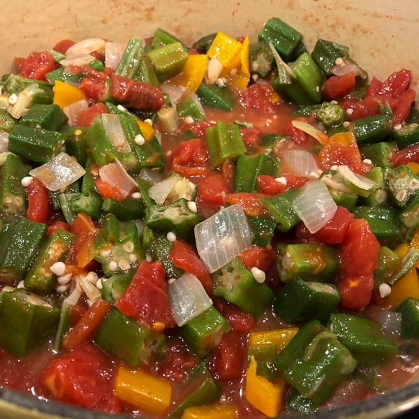 Classic stewed okra and tomatoes with onions, peppers, celery and creole seasoning. A great side dish recipe for any southern or Cajun meal!