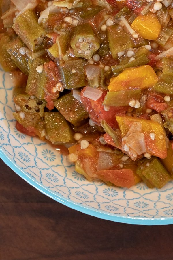 Simple recipe for how to make stewed okra southern side dish. Creole and cajun style with tomatoes, onions and peppers.