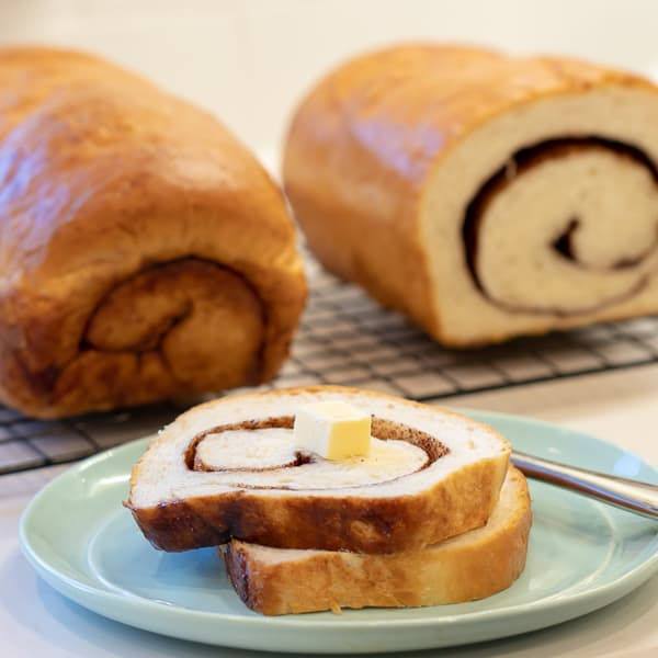 Easy instructions for how to bake cinnamon swirl bread. This recipe makes 2 loaves of fresh sweet cinnamon bread that is great with butter, toasted or used as french toast! Just like a bakery made right at home!