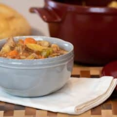Delicious recipe and instructions for how to make pork stew in a dutch oven with pork tenderloin, potatoes, carrots, onions, mushrooms, celery and more.
