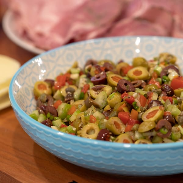 Olive salad spread recipe for muffuletta sandwich made with green and kalamata olives as well as roasted red peppers, capers, celery and green onions.