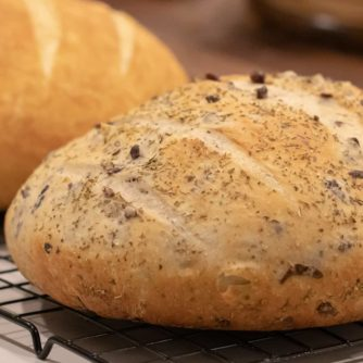 Easy to make rustic olive bread with oregano. Crusty round bread loaf with kalamata olives.