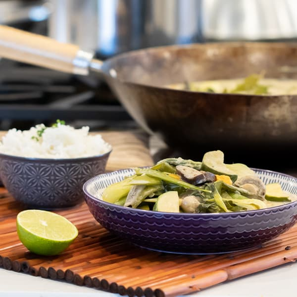 Easy Thai Vegetable Curry with green curry paste and coconut milk. Made with Asian eggplant, baby bok choy, snow peas, mushrooms, zucchini, pepper and more! Serve on jasmine rice.