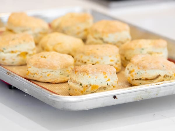 Simple recipe for how to bake cheddar cheese biscuits that are buttery, flakey and simple to make in the oven. Fresh baked and similar to Red Lobster's Cheddar Bay biscuits.