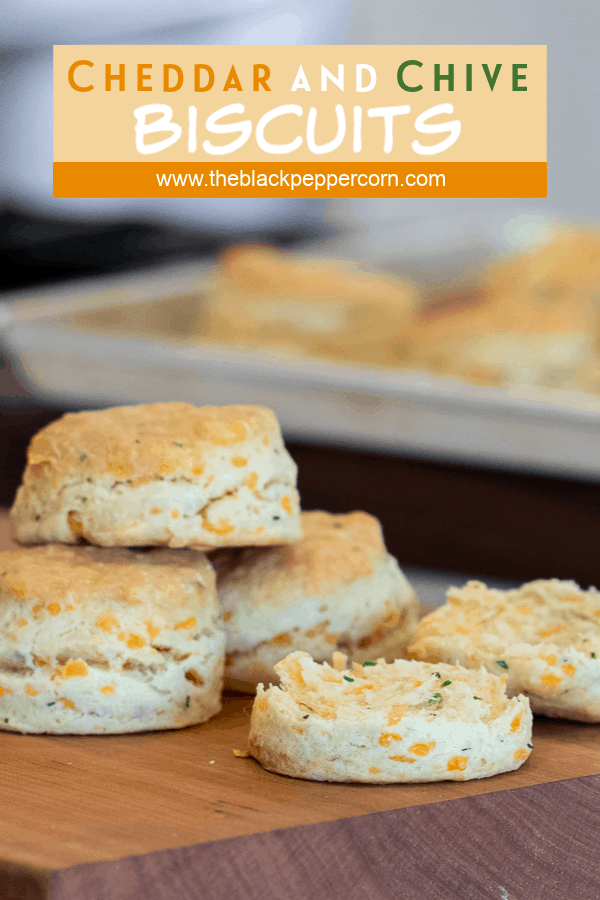 Simple recipe for how to bake cheddar cheese and chive biscuits that are buttery, flakey and simple to make in the oven. Fresh baked and similar to Red Lobster's Cheddar Bay biscuits.