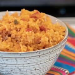 Easy recipe for Mexican rice that is a perfect side dish for a Mexican dinner. Made with rice, salsa & cheese - great in burritos, tacos, fajitas and more.