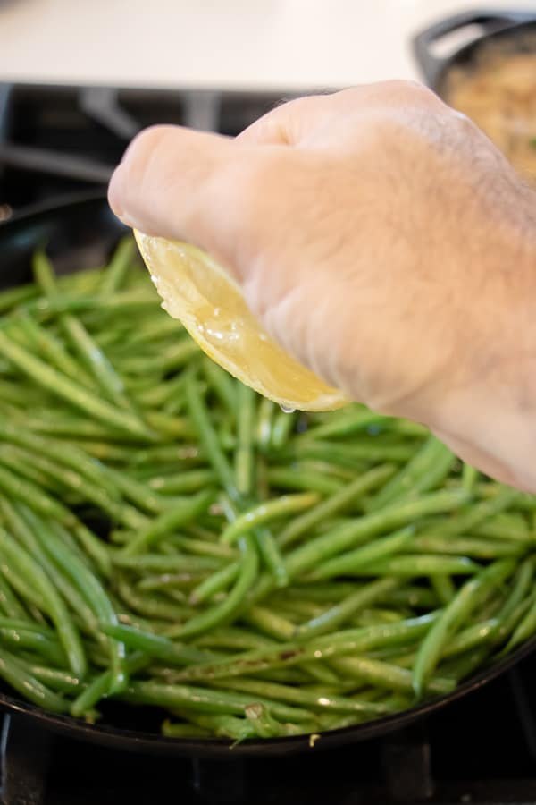 Easy side dish recipe for fresh sautéed green beans with walnuts, dried cherries, lemon zest and lemon juice.
