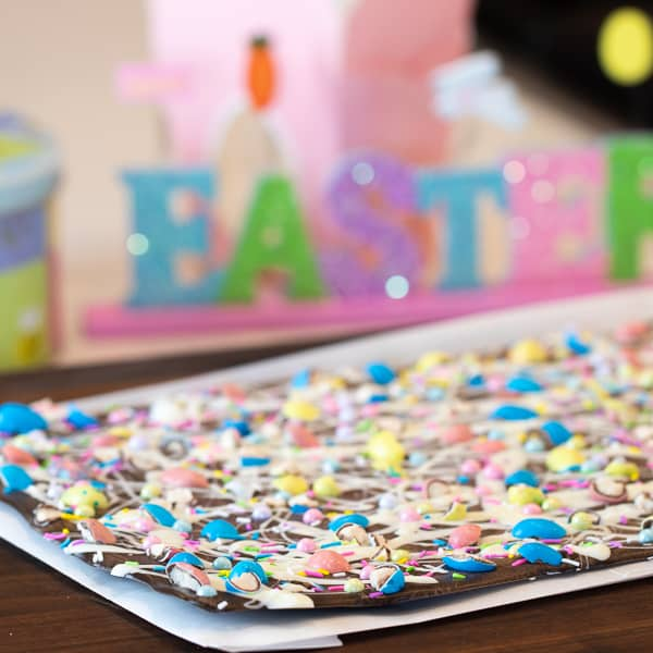 Chocolate bark with a holiday Easter theme. Sweet dessert treat made with dark chocolate melts, white chocolate, malt Easter eggs and sprinkles.