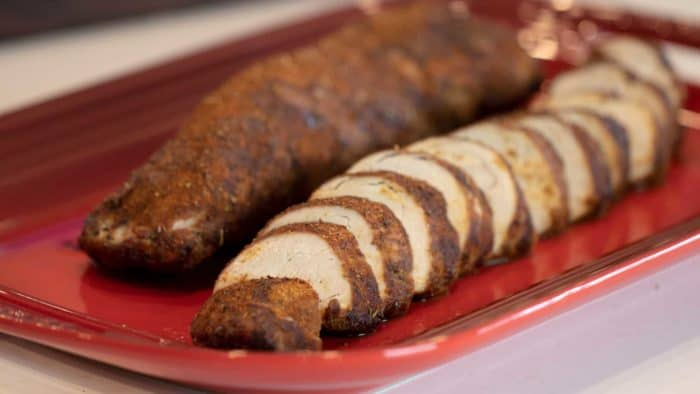 Instructions for how to cook a pork tenderloin in the oven using the bake setting. Tender and juicy meat with a delicious BBQ seasoning rub recipe.