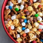 Sweet and salty trail mix recipe made with caramel corn, marshmallows, M&Ms, toasted hazelnuts and mini pretzels. Chocolate, nuts and more, make for a great snack.