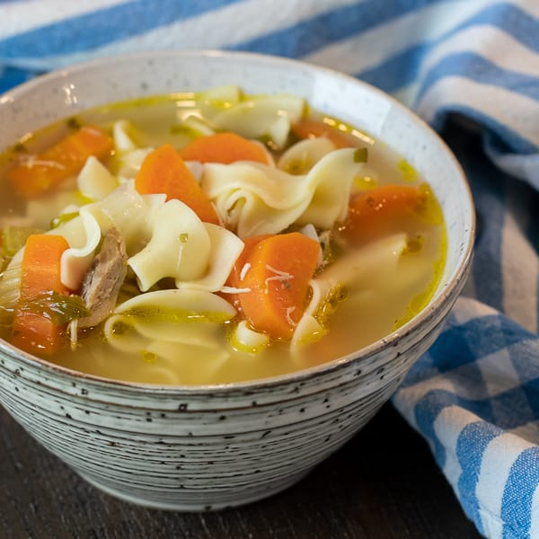 The best chicken noodle soup recipe that is quick and easy. Broth made with roasted or rotisserie chicken carcass. Soup has egg noodles, carrot, celery & onion.