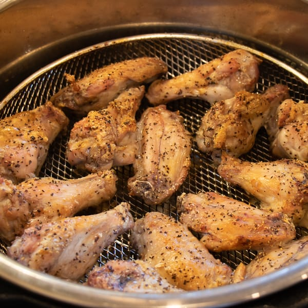 How to cook wings in Air Fryer that are crispy and taste like they are deep fried. Simple instructions for basic salt and pepper chicken wings. Add sauce after for sweet and sticky wings.