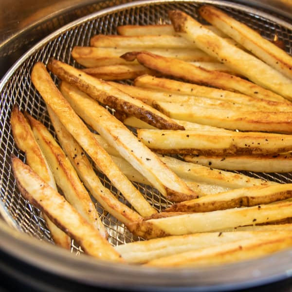 Easy instructions for how to make french fries in an air fryer. Crispy and tastes just like deep fried but this recipe uses very little oil. Russet potatoes make the perfect french fries.