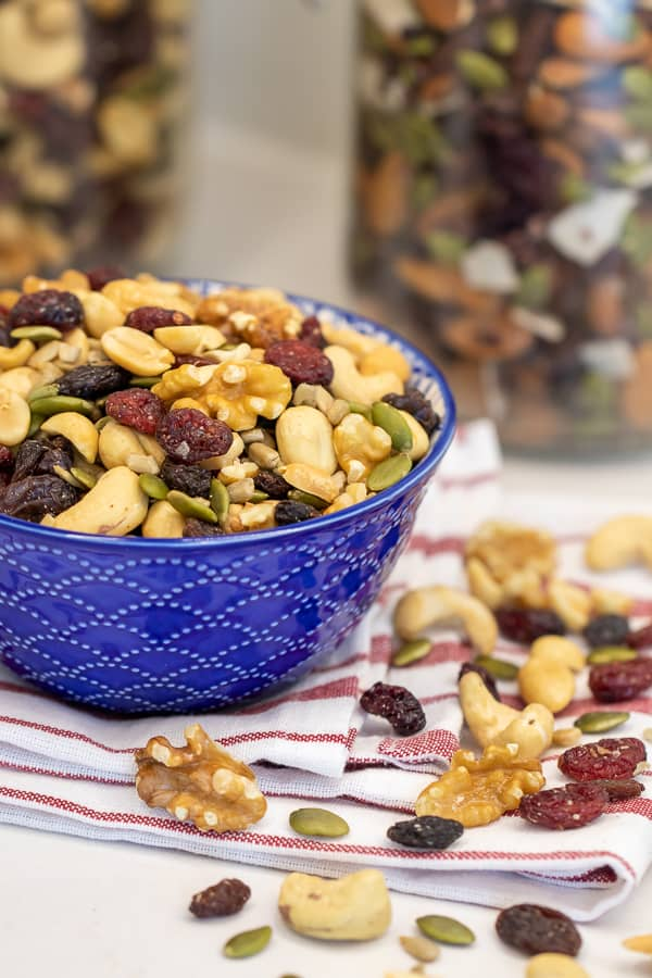 Make your own trail mix at home with a healthy mixture of ingredients. Dried cranberries, raisins, walnuts, cashews, peanuts, pepitas (pumpkin seeds) and sunflower seeds.