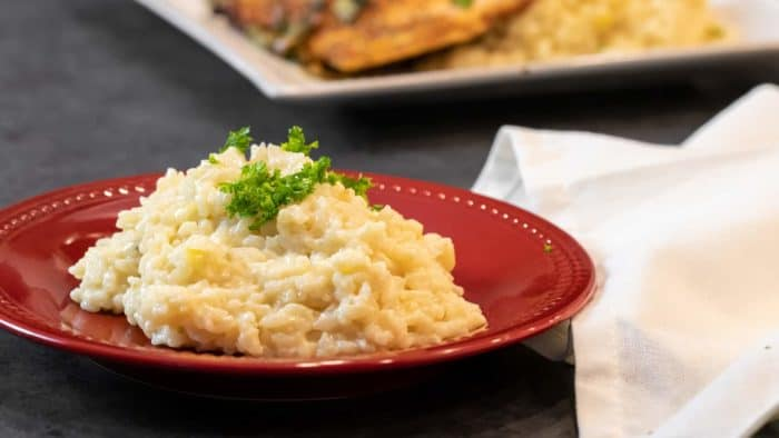 Easy instructions for how to make risotto at home so that it is creamy and tastes just like a restaurant. Made with arborio rice, parmesan cheese, lemon, broth and more.