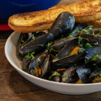Steamed mussels recipe with white wine, shallots, garlic and butter. The best mussels could not be easier to make at home with this simple and delicious recipe.