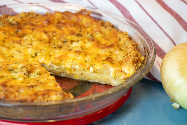 This baked sweet onion pie is a classic southern recipe. Made with Vidalia onions, crackers (Ritz or saltines), eggs, cheese, milk and butter. Delicious savoury pie!