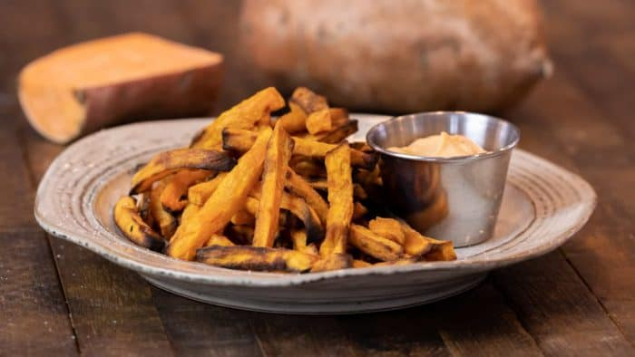 Easy instructions for how to make sweet potato french fries in an air fryer. Crispy and tastes just like deep fried but this recipe uses very little oil. Sweet potatoes make the perfect fries.