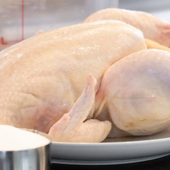 Easy instructions to make a simple brine for a whole chicken including how long to brine and what ingredients to add to the water including salt, sugar, pepper.