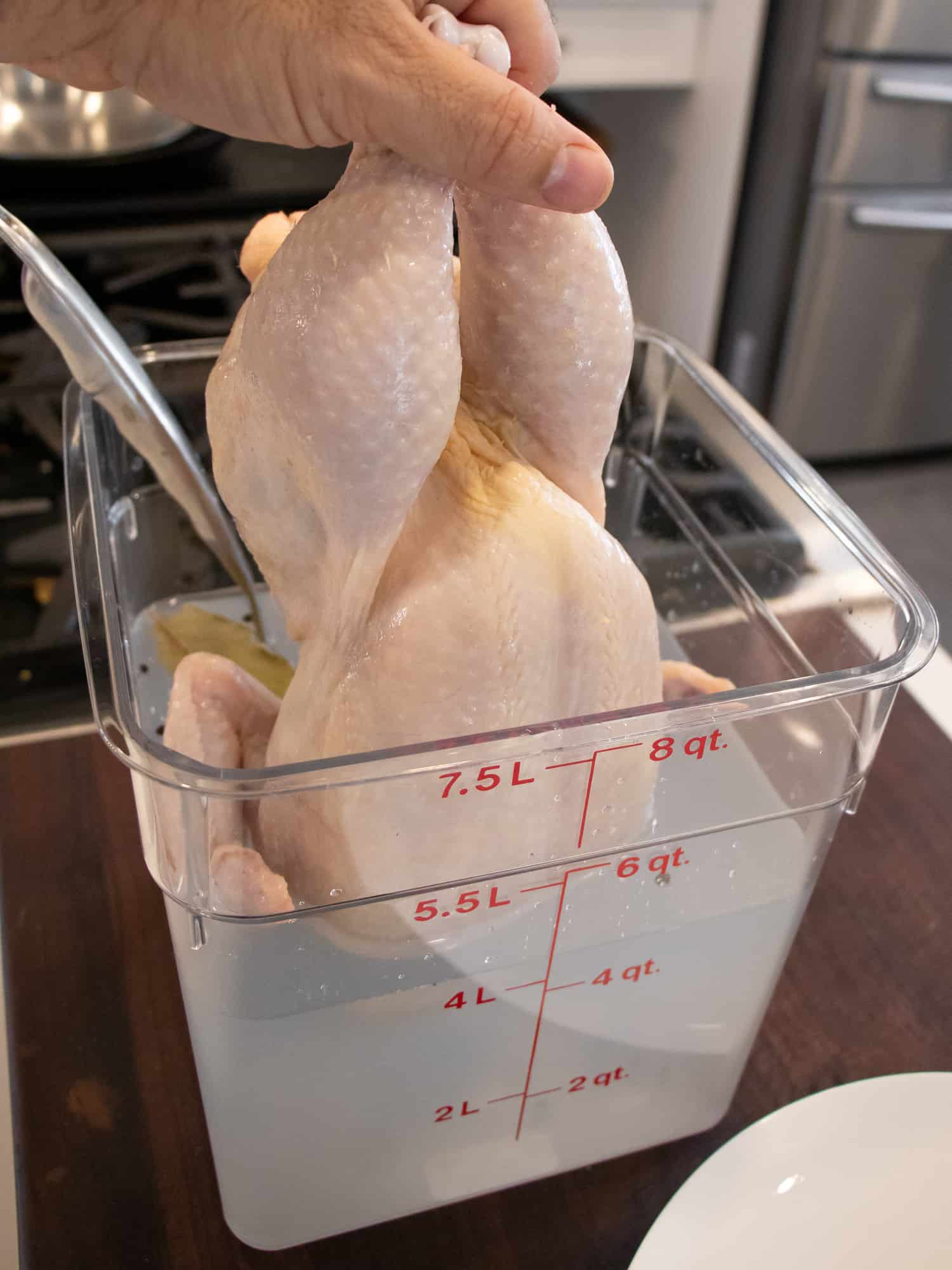 Easy instructions to make a simple brine for a whole chicken including how long to brine and what ingredients to use like salt, sugar, pepper and more.