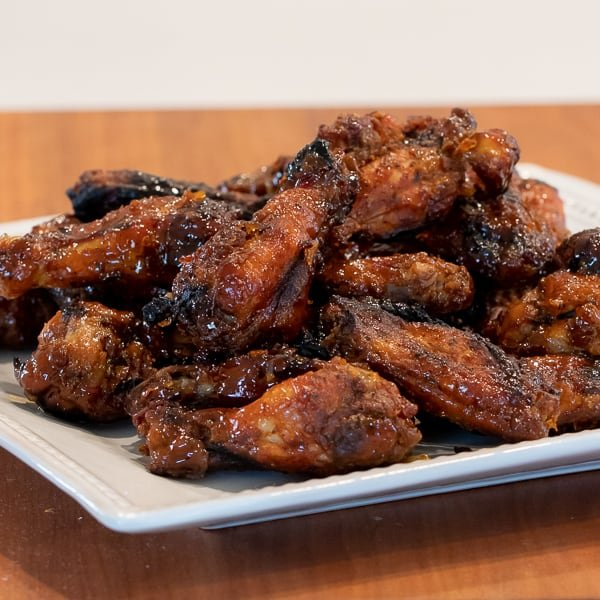 Simple instructions for how to smoke chicken wings with a delicious rub and a sweet and sticky Thai chili glaze.