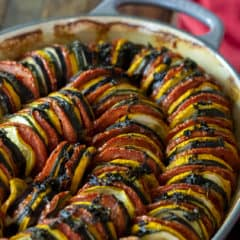 This oven baked ratatouille recipe is a classic French Tian side dish. Made with tomatoes, eggplant, green and yellow zucchini, this is a hearty fall meal.