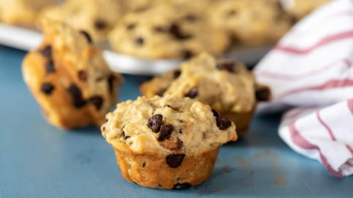 These chocolate chip muffins are a great way to use leftover oatmeal. This very simple recipe yields twelve fresh baked muffins.