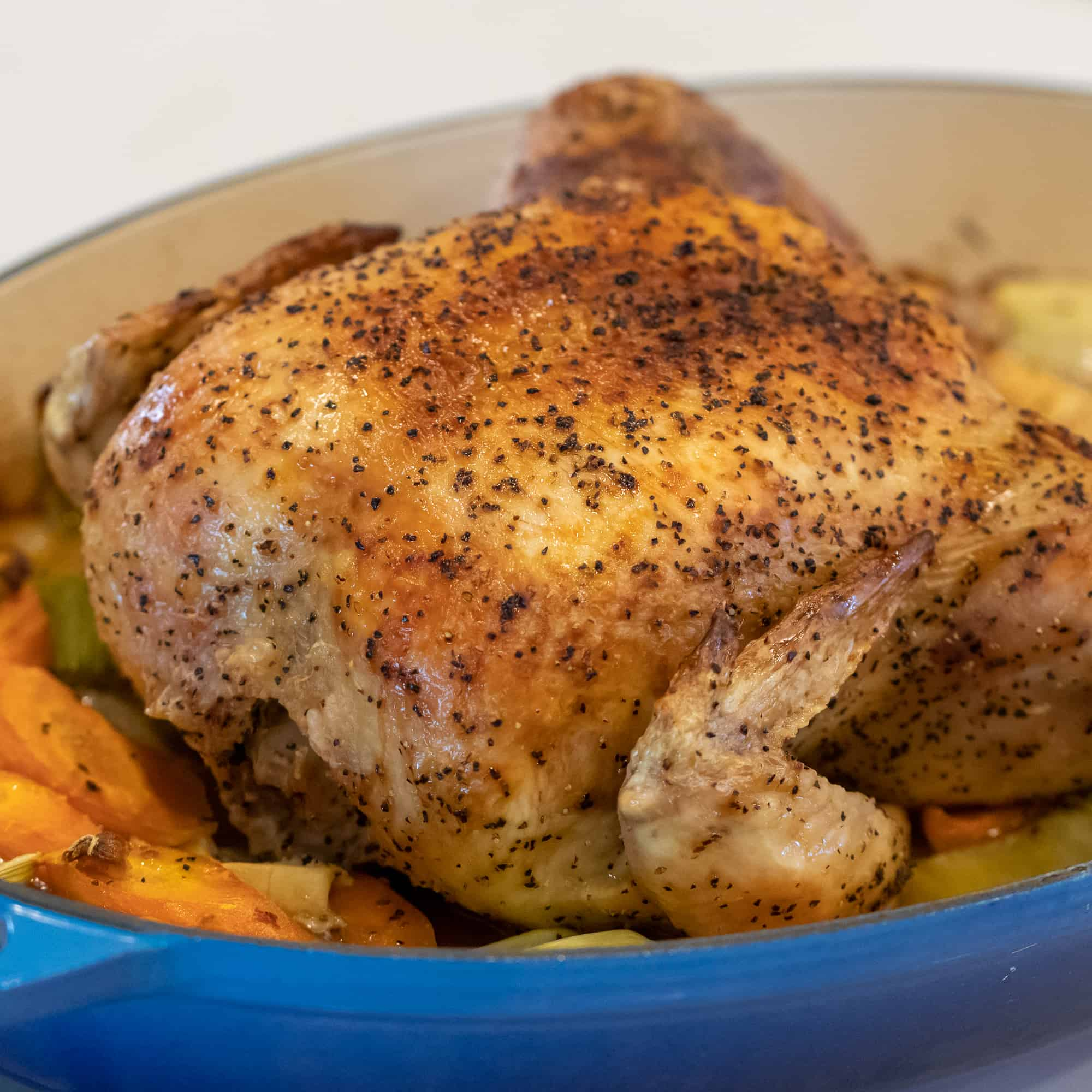 Simple recipe and instructions for how to roast a whole chicken. Tender and juicy chicken that is baked in the oven.