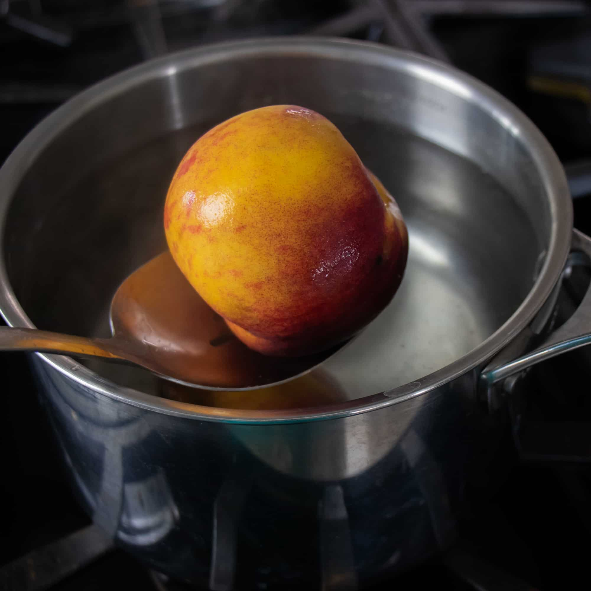 Take the peaches out with a slotted spoon
