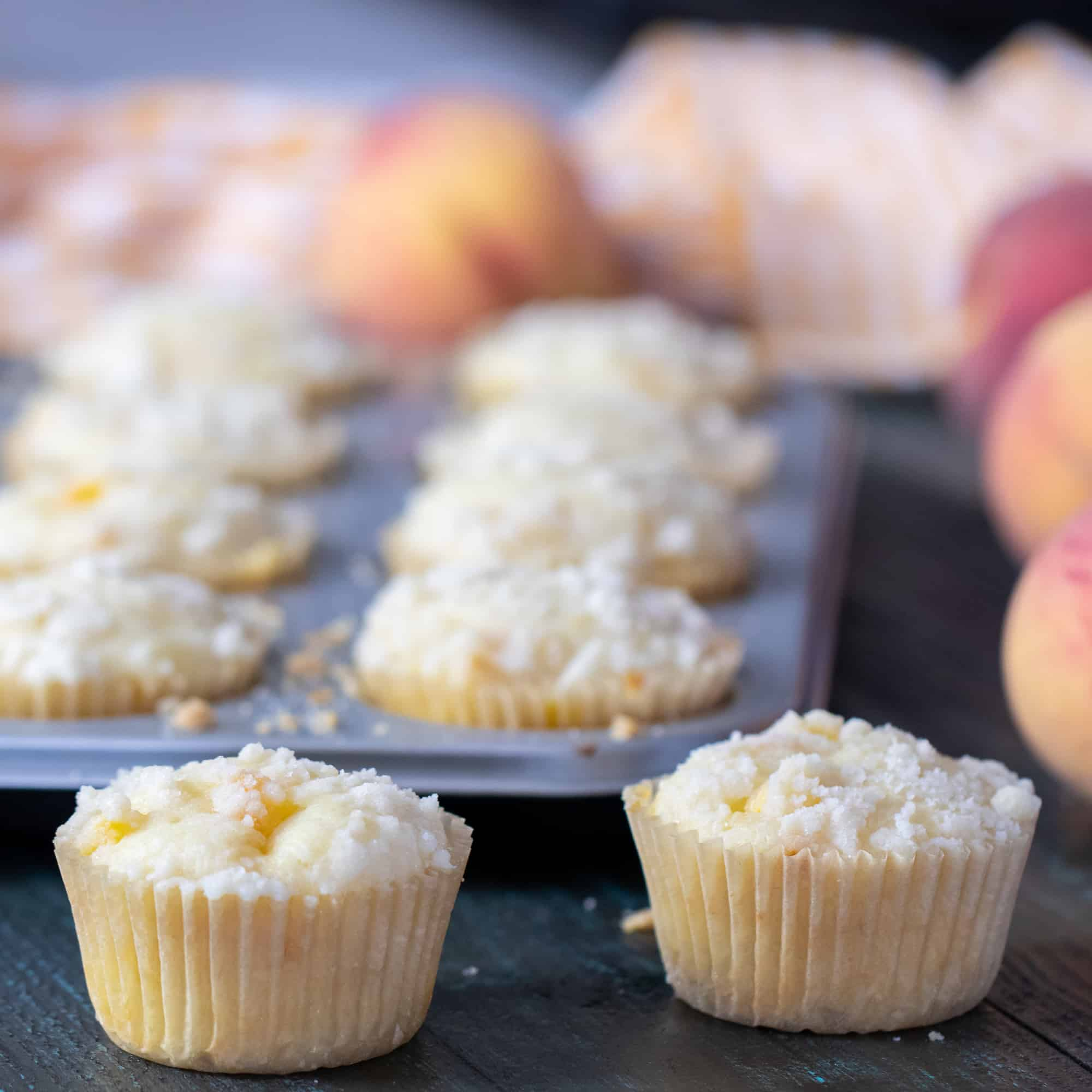 An easy recipe for peach cobbler muffins that is simple and delicious. Fresh Ontario peaches in a light fluffy muffin with a buttery crumble topping.