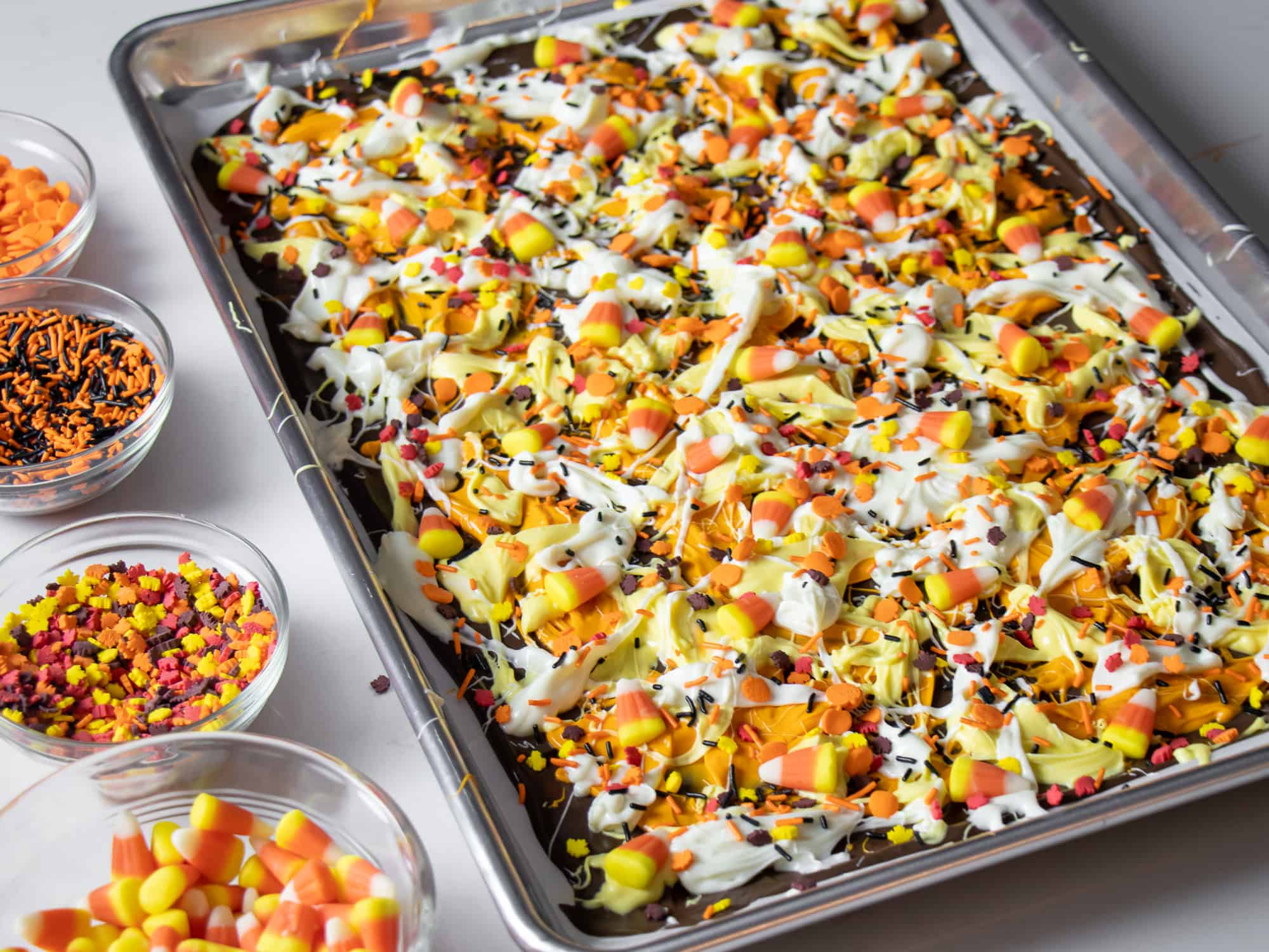 Top with candy corn and sprinkles all over the melted chocolate.