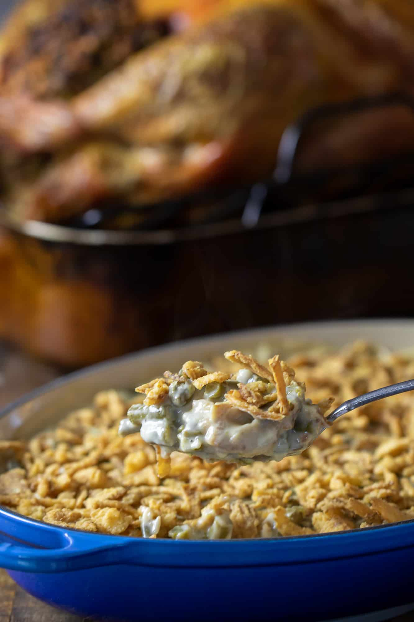 Traditional green bean casserole recipe made with cream of mushroom soup and crispy fried onions. The best holiday Thanksgiving side dish.