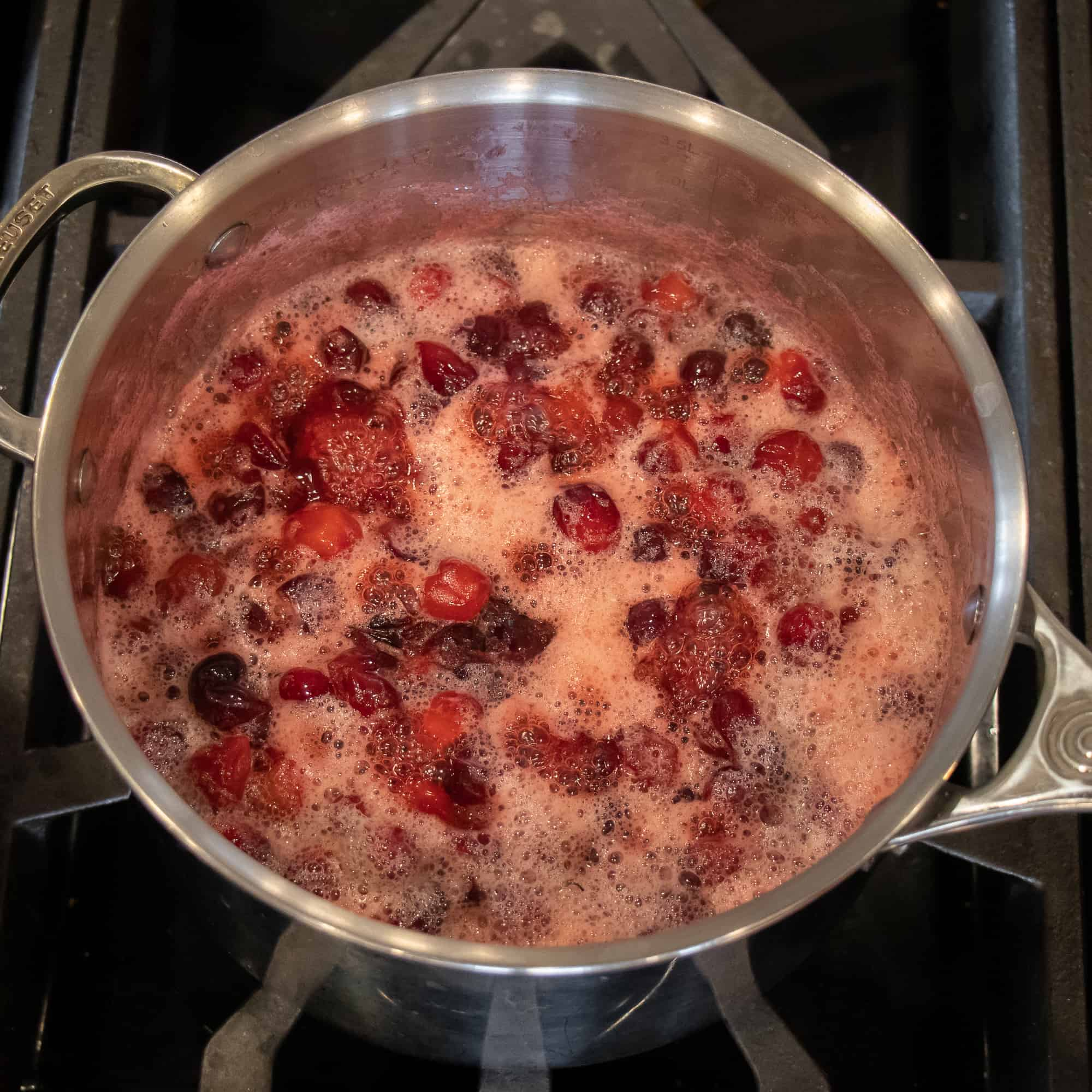 Continue to simmer until the cranberries crack and the sauce thickens.