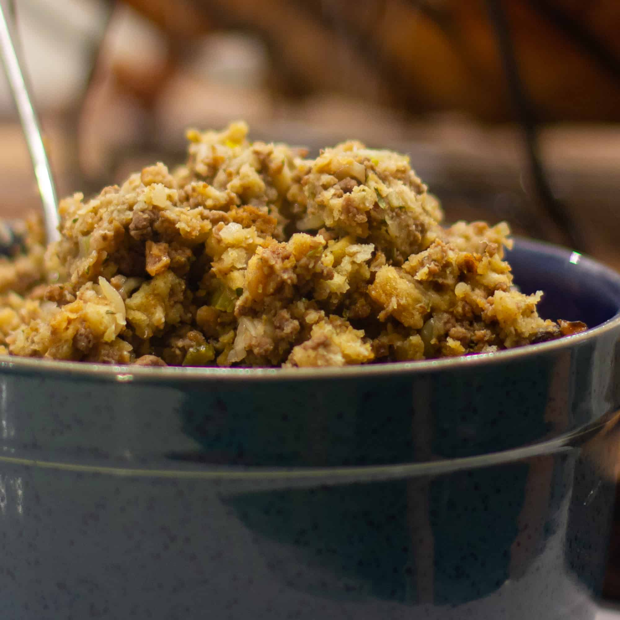 Scoop the stuffing out of the turkey and spoon into a bowl