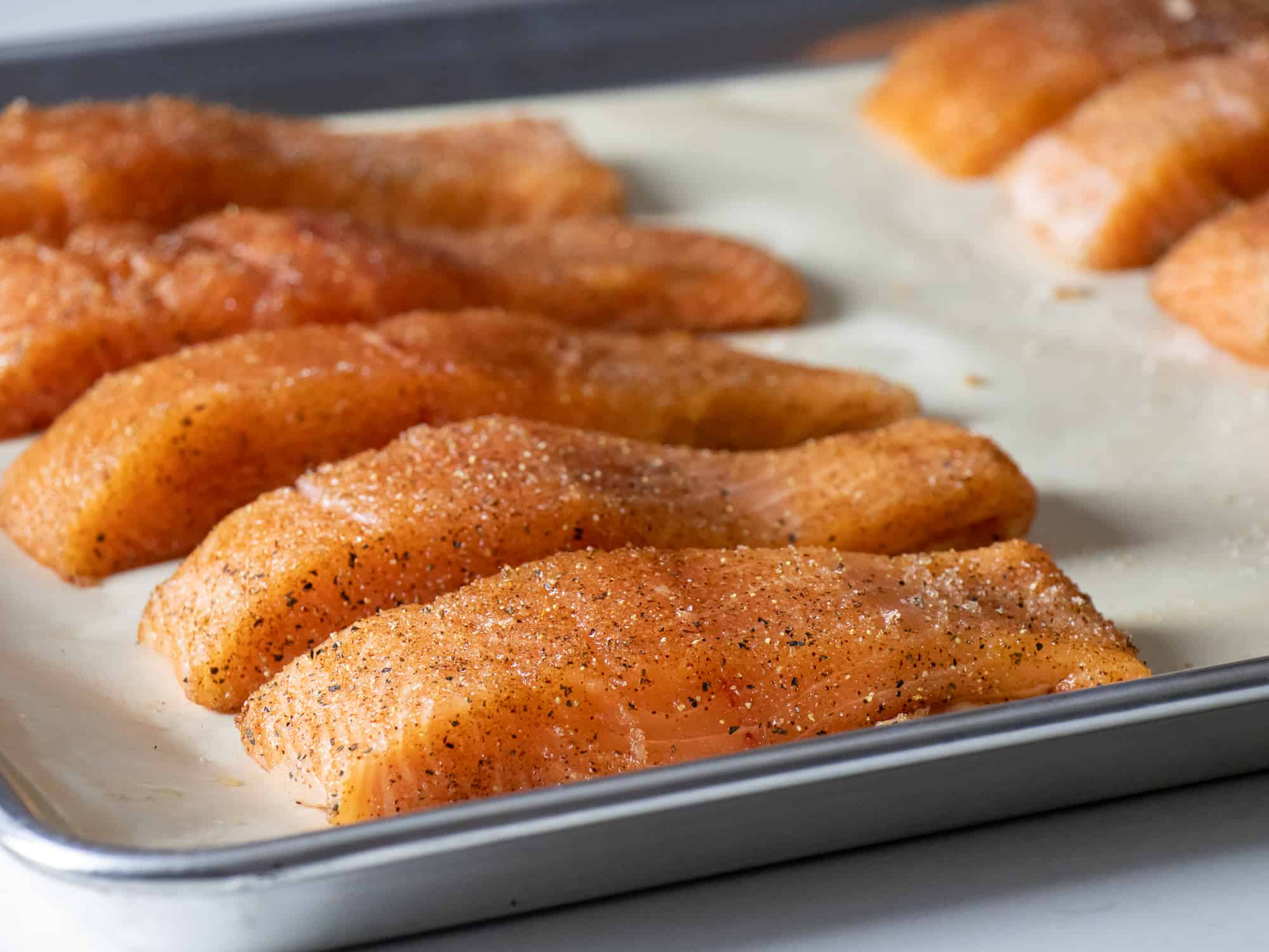 Place the salmon fillets on a baking sheet lined with parchment paper