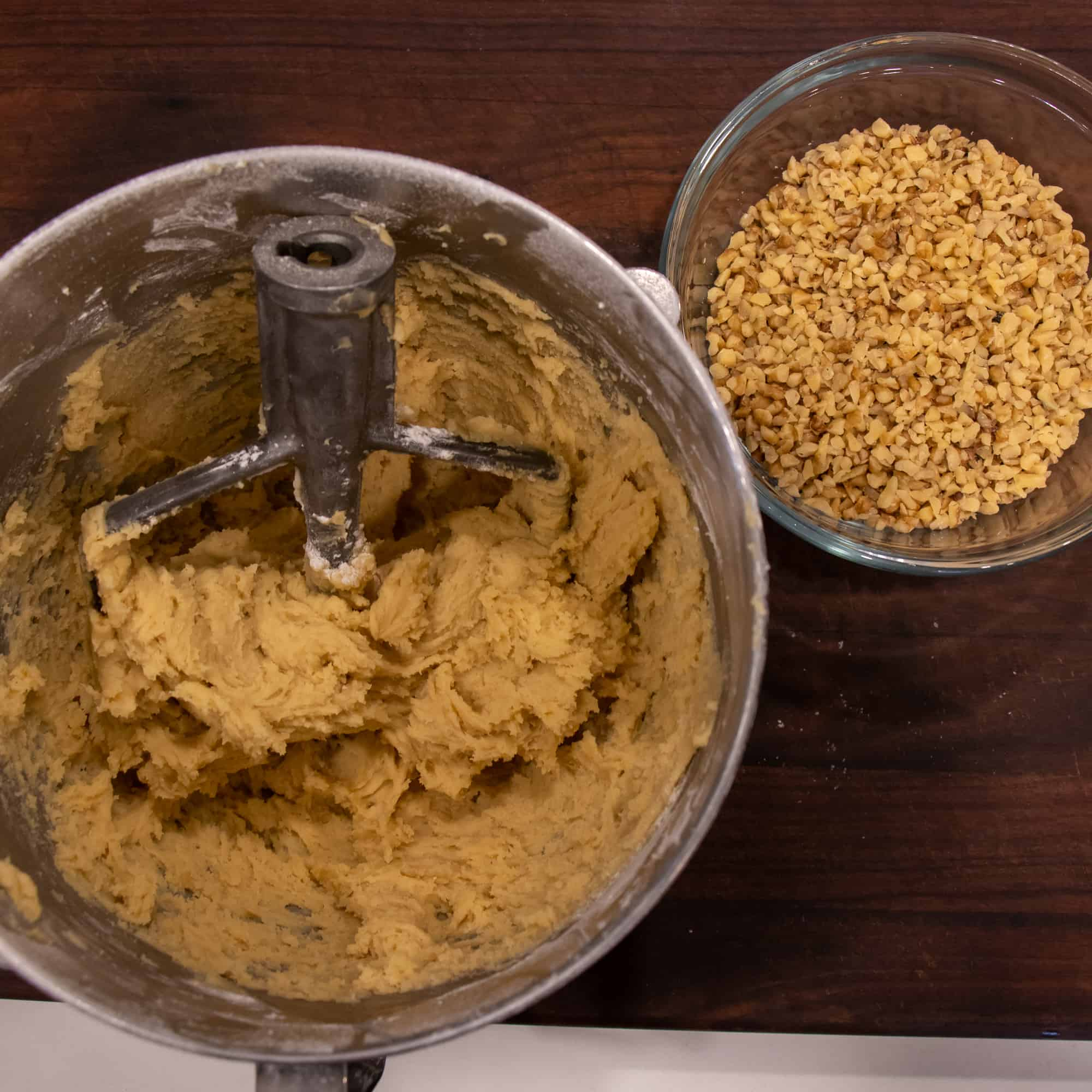 Make the dough with an electric mixer and have it ready along with a bowl of chopped walnuts.