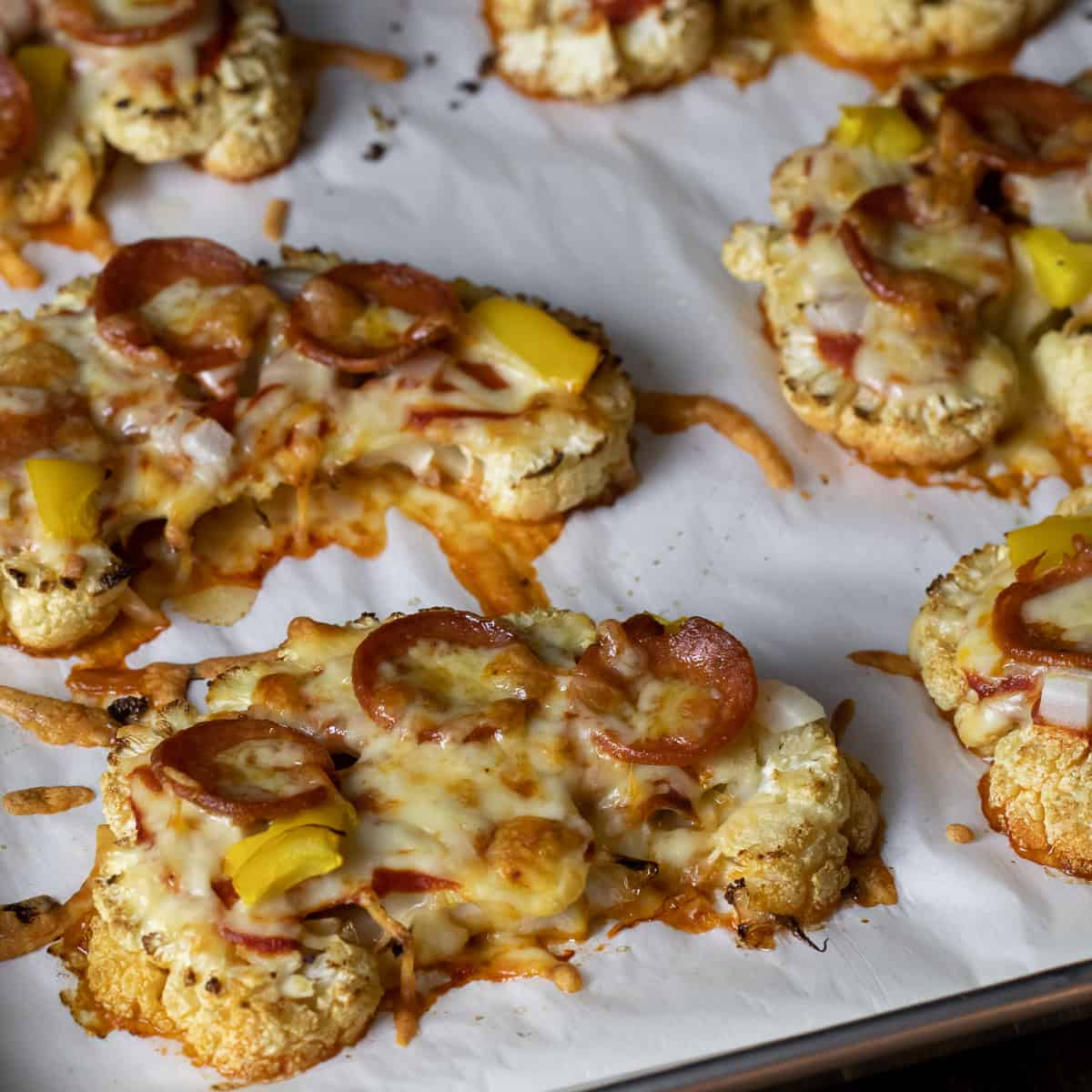 Close up image of cauliflower pizzas.