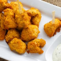 An overhead picture of a plate of nuggets with dipping sauce.