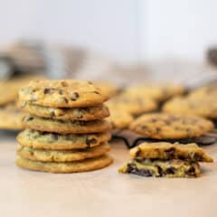 A stack of cookies with one broken in half.