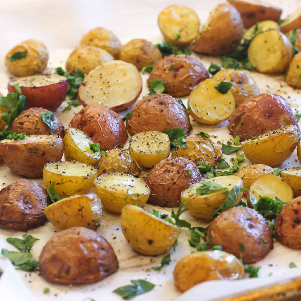 Roasted potatoes garnished with fresh parsley.