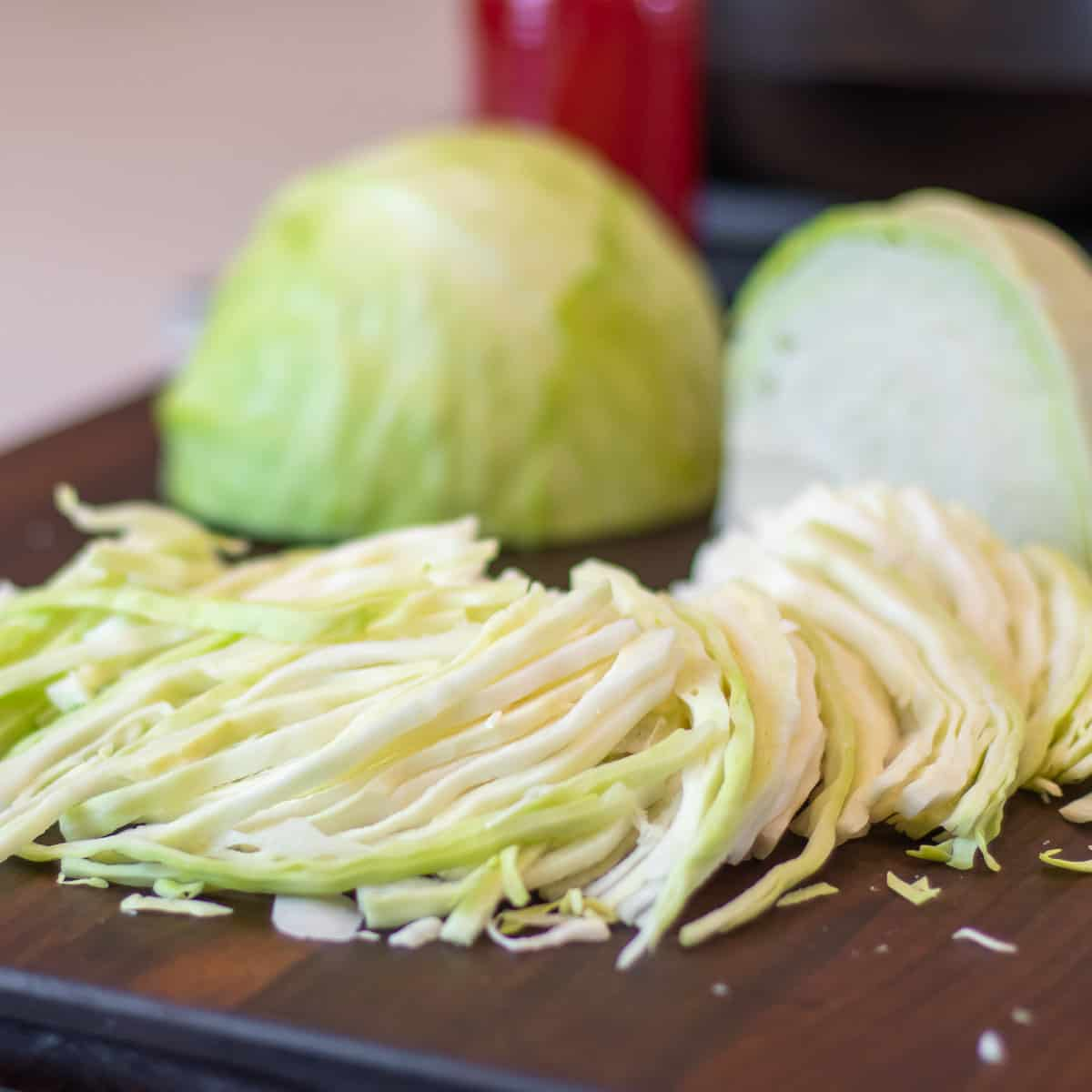 Slicing cabbage on a cutting board.