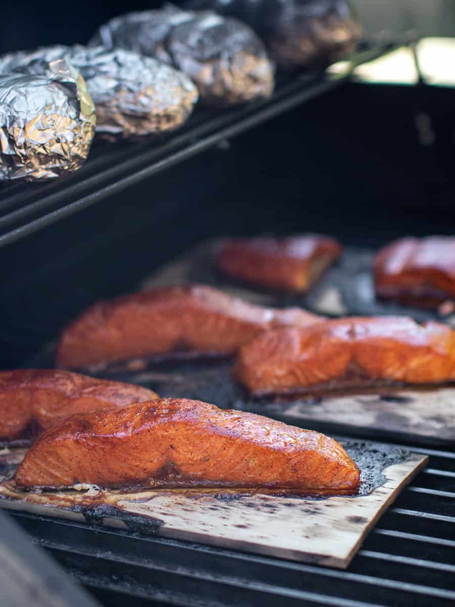 Cooked salmon still on the grill.