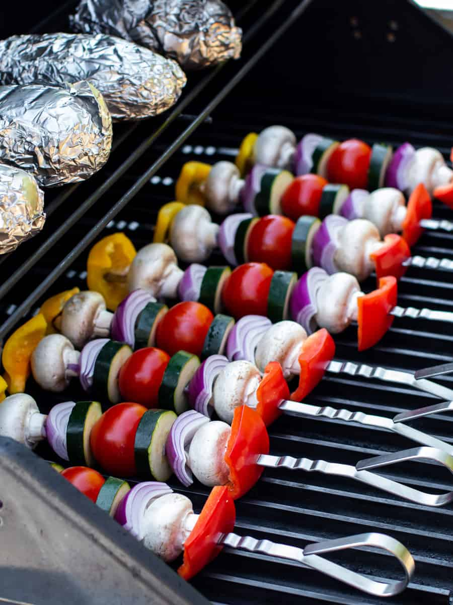 Raw veggie kabobs on the grill.