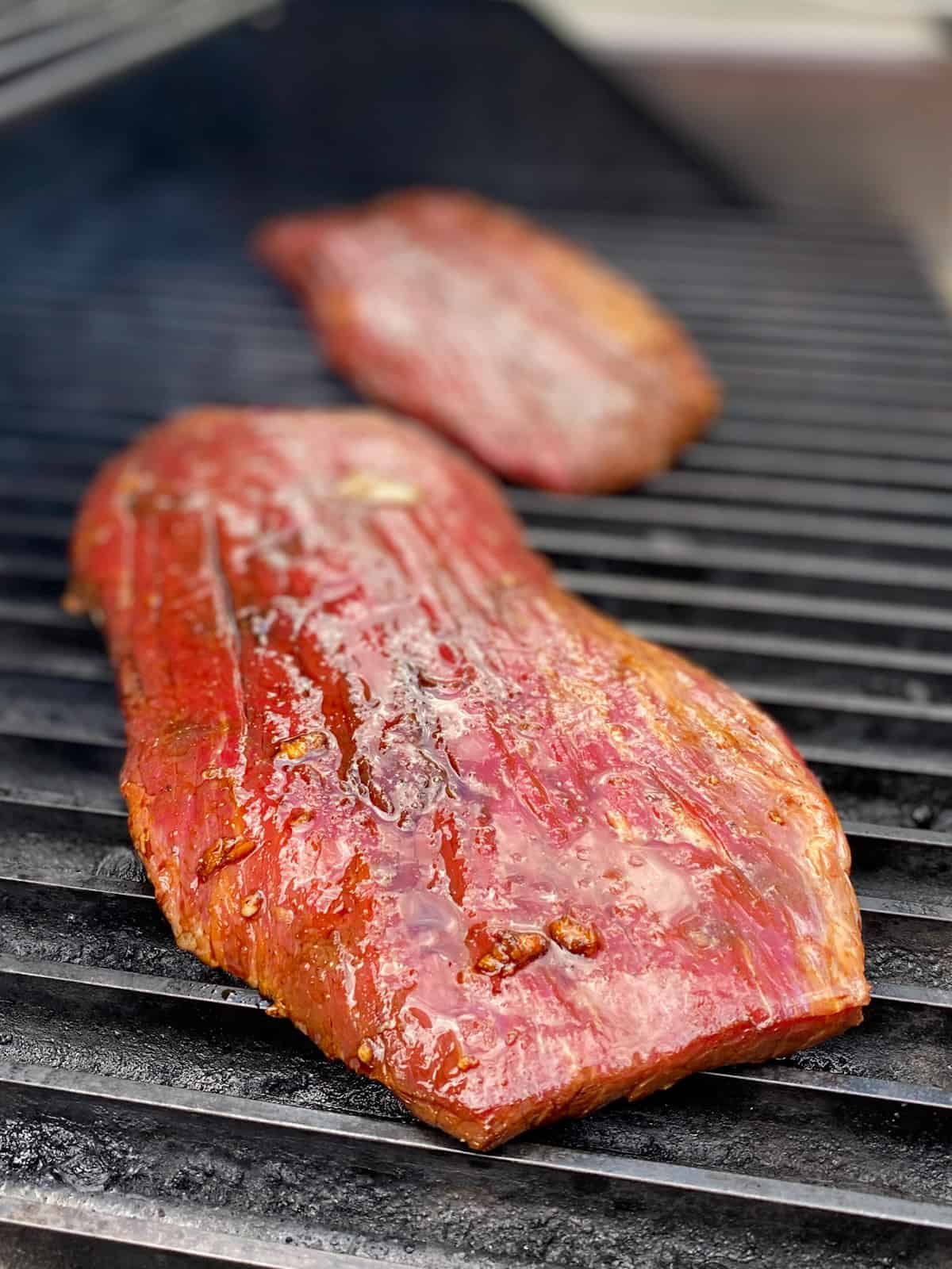 Flank steaks on a hot grill.