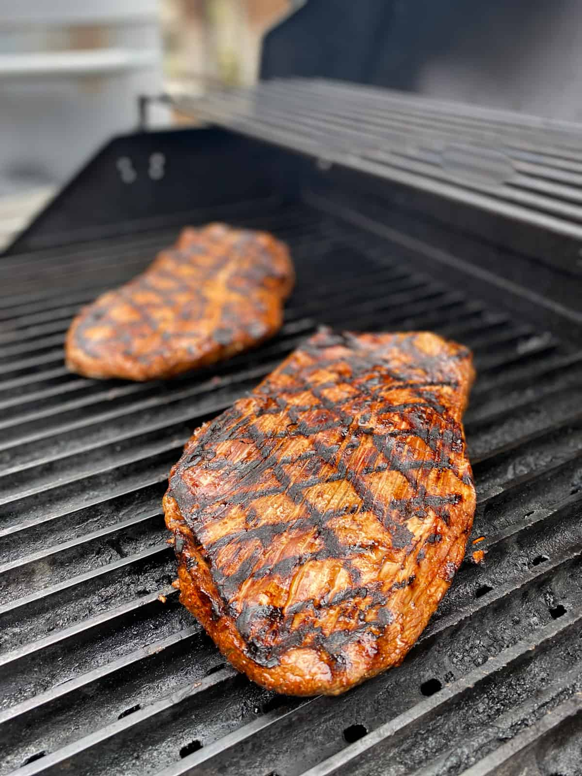 Flank steaks with grilled char lines.