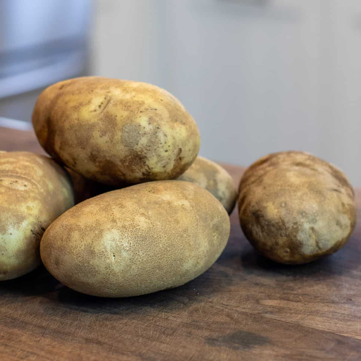 A pile of russet potatoes.